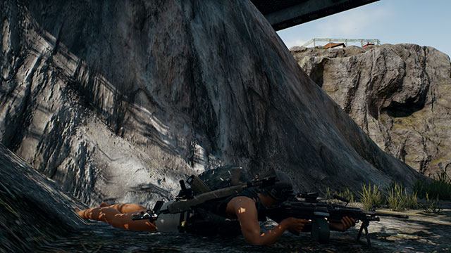 In-Game Screenshot of Player laying prone with the M249 Light Machine Gun