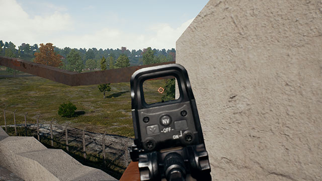 In-Game Screenshot of a Player Leaning Around a Corner with a Holographic Sight in PUBG