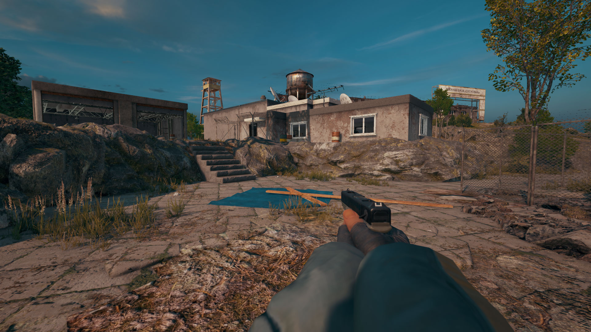 FPP screenshot of PUBG player on Spawn Island holding a P18C pistol.